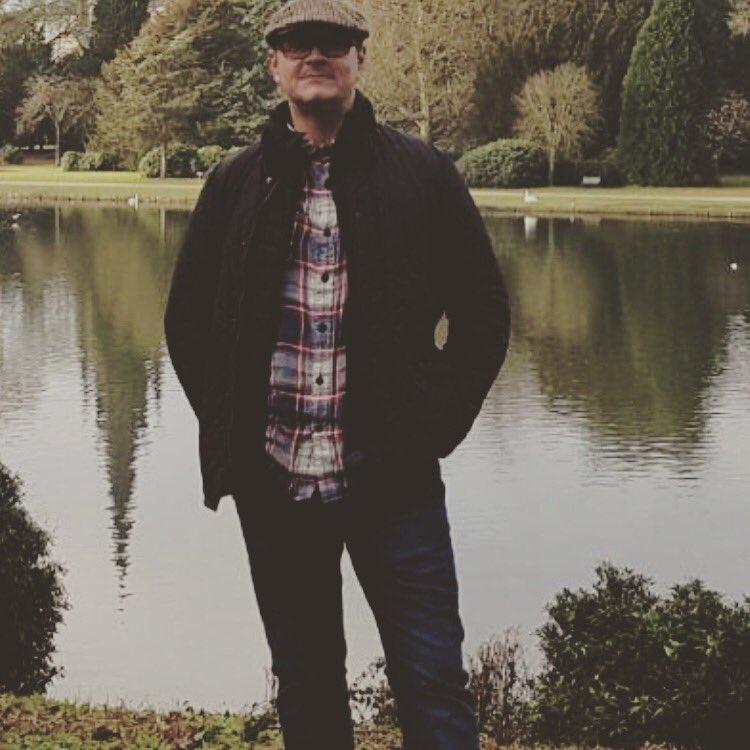 Mark Tomlinson  adoptive father